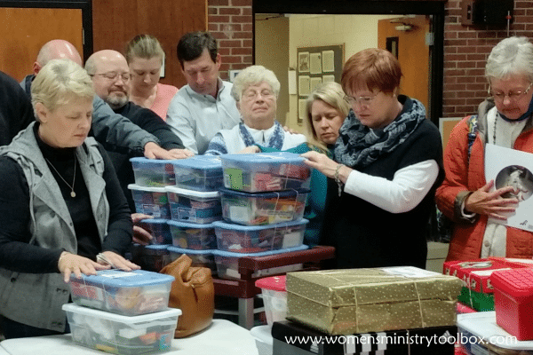 Praying over Operation Christmas Child Shoeboxes